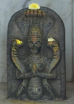 Ancient Sumari God Enlil embracing two serpents