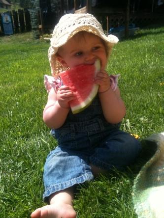 Amazing baby Grace enjoying summertime watermelon
