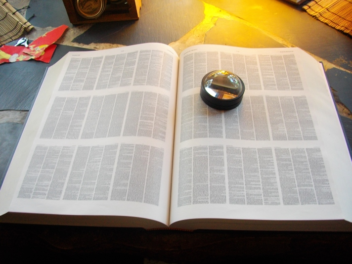 my dearly cherished complete, unabridged, Oxford English Dictionary printed so small that it comes with a magnifying glass!