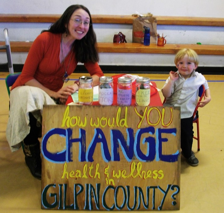 "Mommy and ""Dr."" Jimmy with hands-on health literacy activities for kids and our fundraiser/poll at the Gilpin County Fair"