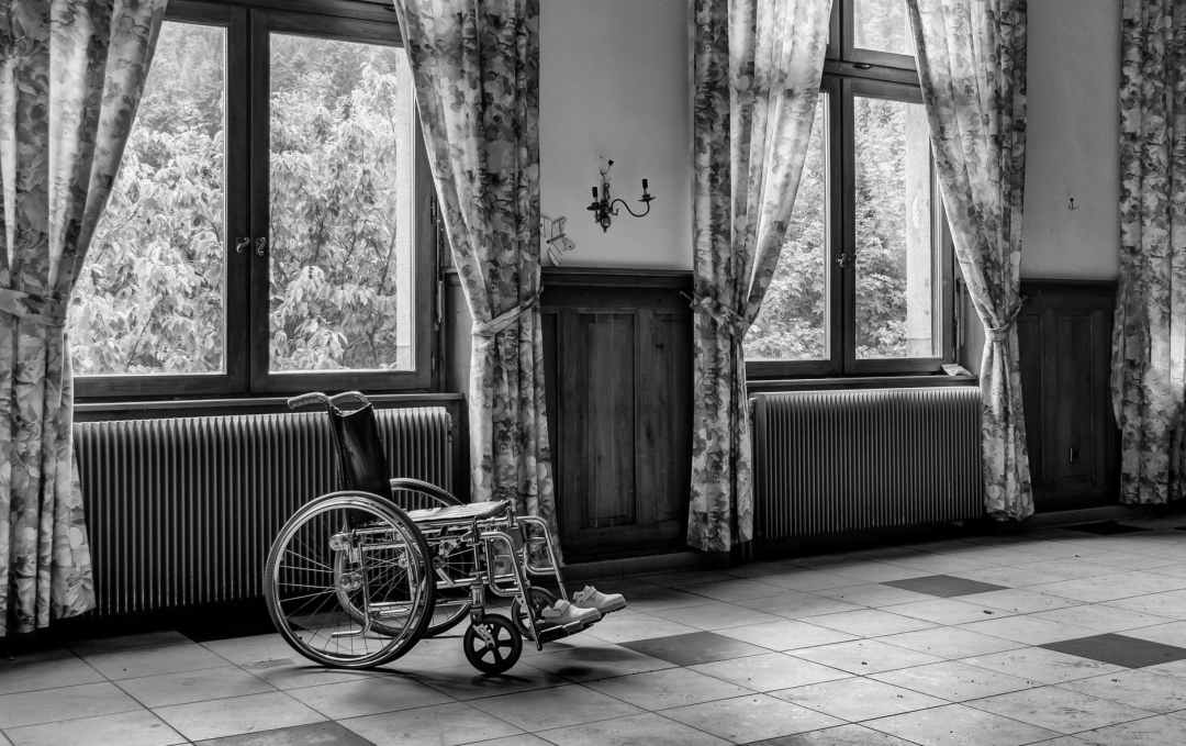 grayscale photo of wheelchair